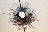 Bullet hole in window — Stock Photo