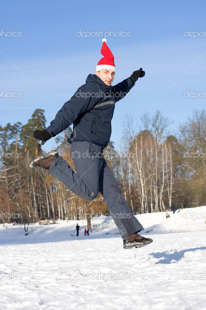 Man jumping on a background the forest in winter  Stock Photo #8328033