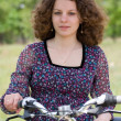 Girl with a bicycle — Stock Photo #8412880