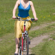 Girl goes by bicycle — Stock Photo
