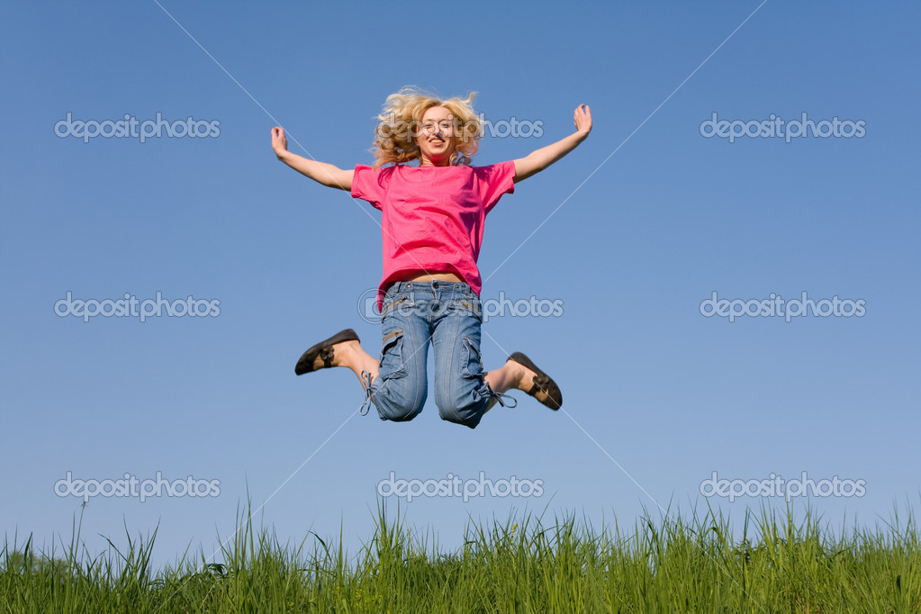 Girl jumping on the green meadow — Stock Photo #8412843