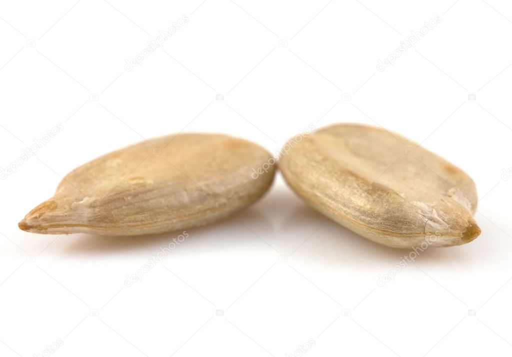 Sunflower seeds detail isolated on white — Stock Photo #8412993