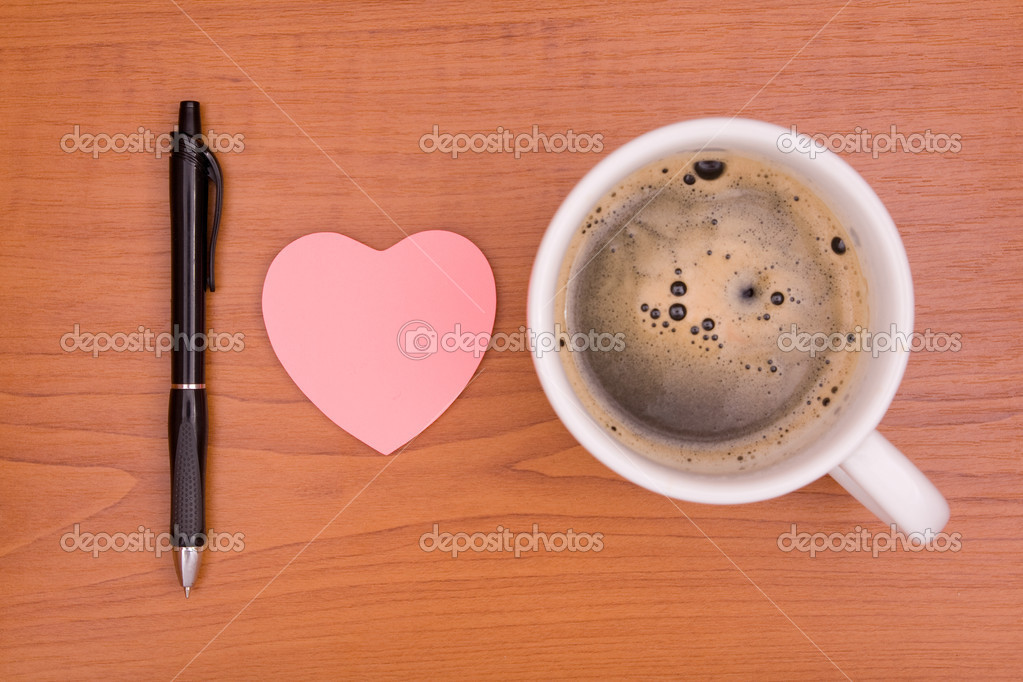 Stickers , pen and cup of coffee on a desk — Stock Photo #8413176
