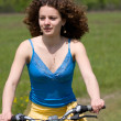 Stock Photo: Girl goes by bicycle