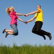 Jumping couples — Stock Photo