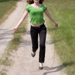 Stock Photo: Girl with skipping rope