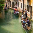 Stock Photo: Tourists travel on a gondolas