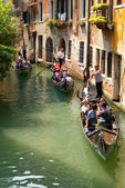 Tourists travel on a gondolas — Stock Photo