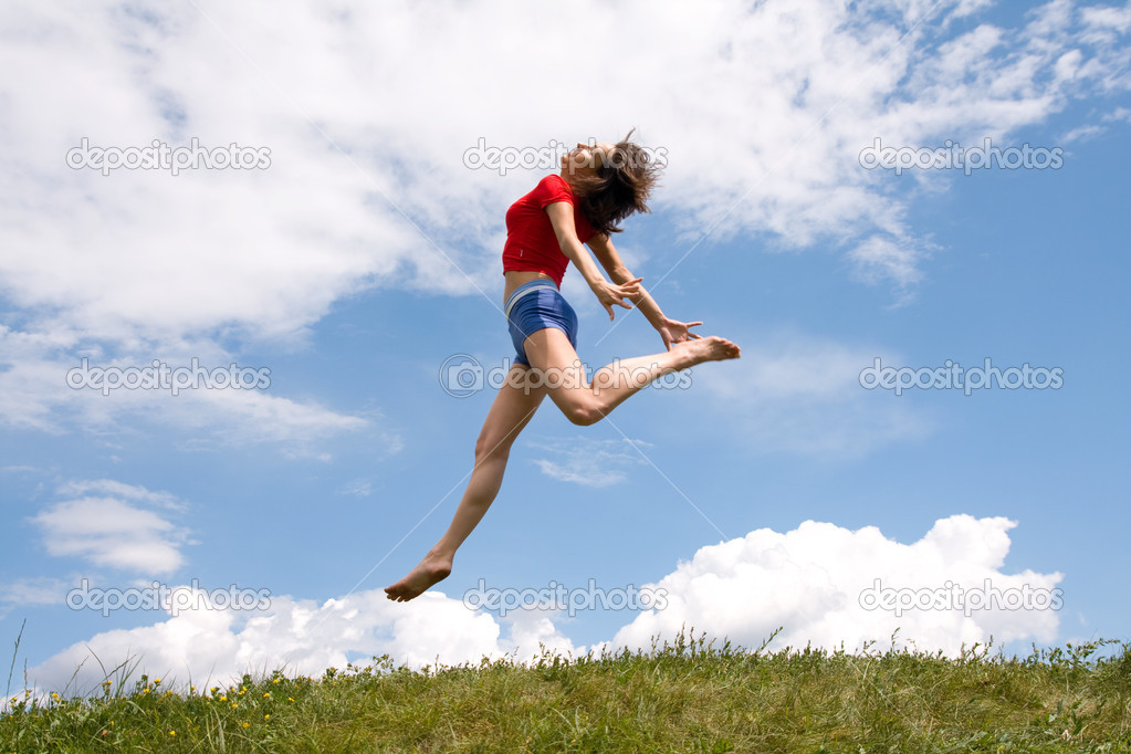 Jumping girl on the green meadow — Stock Photo #9229122
