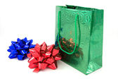 Green package and two bows — Stock Photo