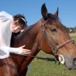 Fiancee on a horse — Stock Photo