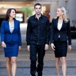 Group of Business walking outside — Stock Photo