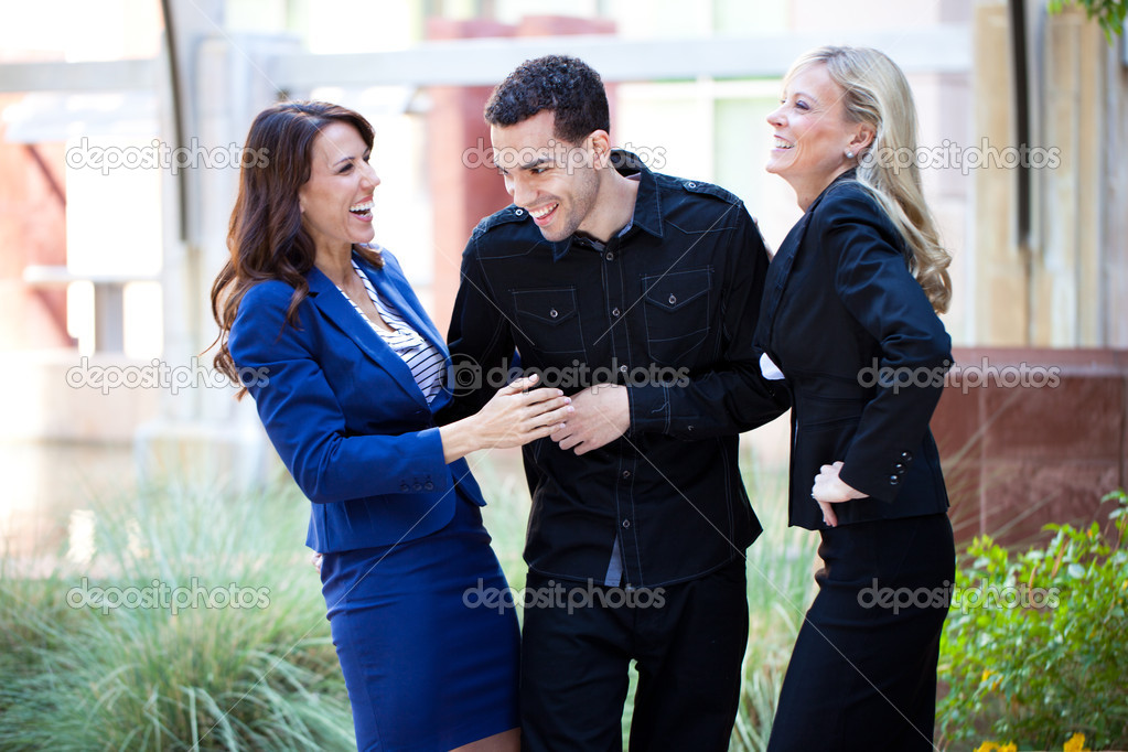 Group of Business Smiling and laughing outside the office — Stock Photo #10395275