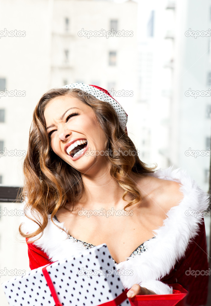 Beautiful Woman in a sexy santa outfit with a present  Stok fotoraf #8099060
