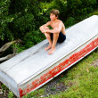 Teenager on Sitting on a Boat - Foto Stock