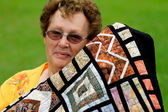 Pretty Senior Woman and her Quilt — Stock Photo