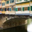 Closeup of Bridge Ponte Vecchio over Arno river in Florence, Ita - Stock Photo