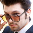Handsome Guy looking over sunglasses — Stock Photo