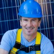 Handsome Man and Solar Panels - Stock Photo