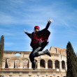 Woman jumping with scarf - Stockfoto