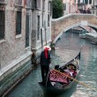 Gondolier and gondola — Stock Photo