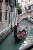 Gondolier and gondola — Stock Photo