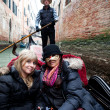 Beautifiul women riding on gondola during Carnival — Stock Photo