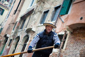 Gondolier navigates on the channel of Venice — Stock Photo