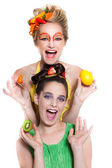 Beautiful Women decorated with Fresh Fruit and Vegetables — Stock Photo