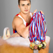 Gymnast with medals — Stock Photo