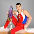 Gymnast with medals — Stock Photo #8205598