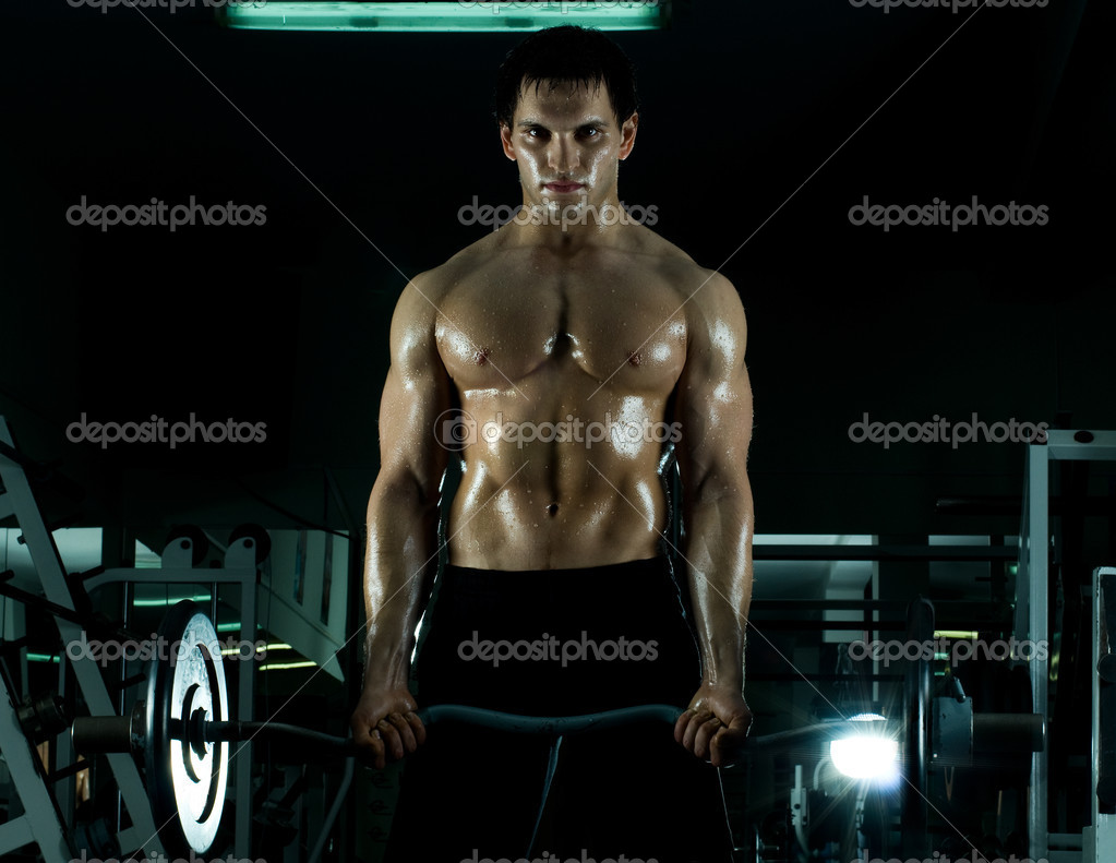 Very power athletic guy ,  execute exercise with  weight, in  sport-hall, beauty glamour light — Stock Photo #8205323