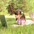 Little girl with computer — Stock Photo #8217723