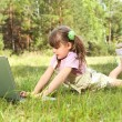 Little girl with computer — Stock Photo