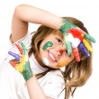 Little beautiful girl and paint — Stock fotografie
