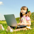 Little girl with computer — Stock Photo #8217837