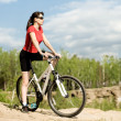 Beautiful woman bicyclist - Stock Photo