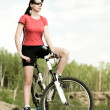 Beautiful woman bicyclist — Stock Photo