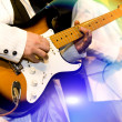 Guitar-player plays an electroguitar — Stock Photo