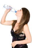 Beautiful girl drinks — Stock Photo