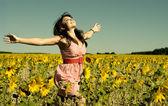 Beautiful woman runs on a glade — Stock Photo