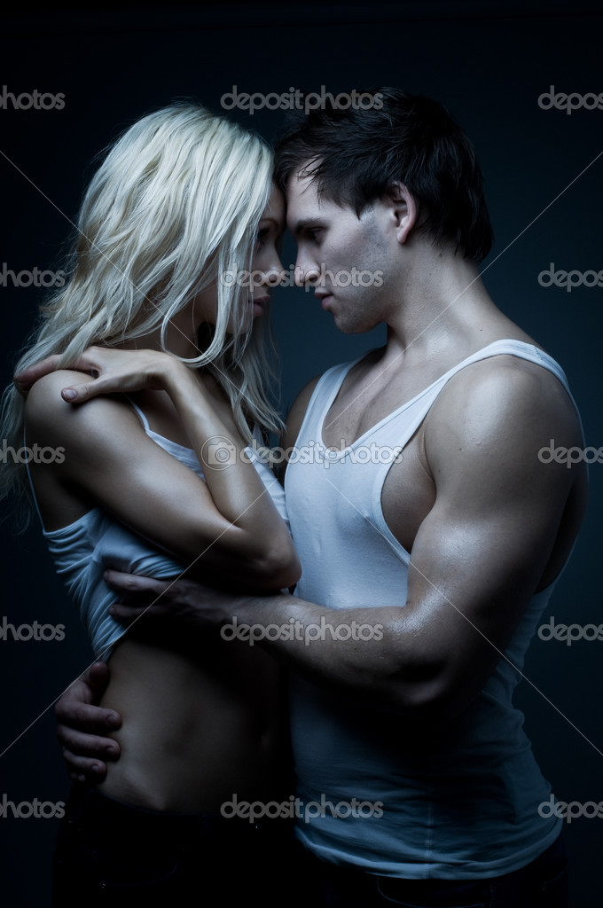 Muscular handsome sexy guy with pretty woman, on dark background, glamour blue light — Photo #8220402