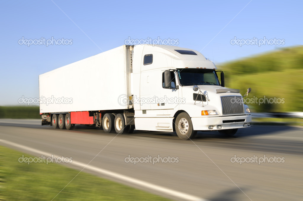The empty lorry white, quickly rushes on highway, on a background of the beautiful nature — Stock Photo #8220988