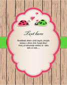 Wooden card with ladybirds in love. — Stockfoto