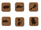 Wooden icons set with pets silhouettes. — Stock vektor