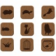 Wooden icons set with pets silhouettes - Stock Vector