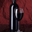 Bottle with red wine and glass — Stock Photo