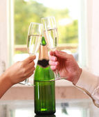 Image of human hands holding the glasses of champagne making a toast — Stock Photo