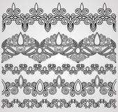 Black flowers ornaments — Cтоковый вектор