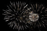 Fireworks on a dark night sky — Stock Photo